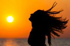 Woman waving hair at sunset Royalty Free Stock Image