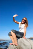 Woman waving hand Royalty Free Stock Photos