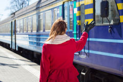Woman waving hand on the platform Royalty Free Stock Images