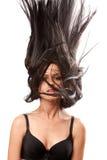 Woman waving her hair Stock Image