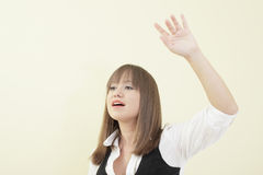 Woman waving her hand Royalty Free Stock Photo