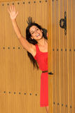 Woman waving at house entrance Royalty Free Stock Photography