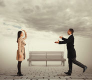 Woman waving man going to meet Royalty Free Stock Photo