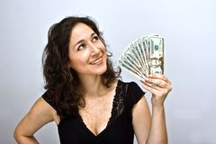 Woman waving money Royalty Free Stock Image