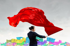 Woman waving red flag Stock Image