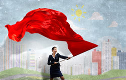 Woman waving red flag Stock Photo