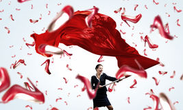 Woman waving red flag Royalty Free Stock Photography