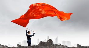 Woman waving red flag Royalty Free Stock Images