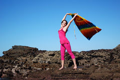 Woman waving shawl in air Royalty Free Stock Images