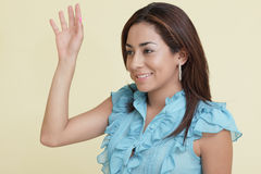 Woman waving and smiling Stock Images