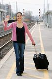 Woman waving at train station Royalty Free Stock Photography