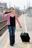 Woman waving at train station Royalty Free Stock Photography
