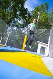 Woman waving on trampoline Royalty Free Stock Images