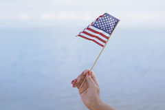 Woman waving US flag Royalty Free Stock Photography