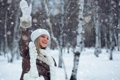 Woman waving in winter park Royalty Free Stock Photos