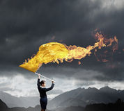 Woman waving yellow flag Royalty Free Stock Photography