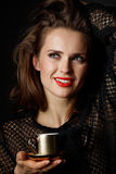 Woman with wavy brown hair and red lips holding cup of coffee Royalty Free Stock Images