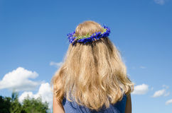 Woman wavy hair and flower crown on sky background Stock Photo