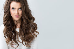 Woman with wavy hair. Royalty Free Stock Image