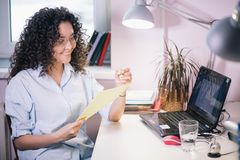 Woman with wavy hair an yellow manicure thinking up funny stories. Female with wavy hair an yellow manicure thinking up funny stories Royalty Free Stock Photography