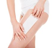 Woman Waxing Her Leg. Close-up Of Woman Waxing Her Leg Over White Background Stock Image