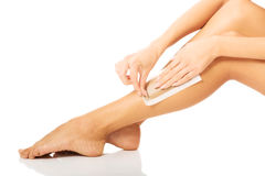 Woman waxing her leg. Spa woman waxing her leg Royalty Free Stock Images