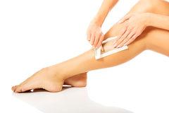 Woman waxing her leg. Spa woman waxing her leg Royalty Free Stock Photography