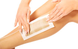 Woman waxing her leg Stock Photo