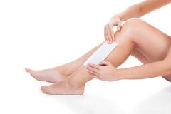 Woman Waxing Her Legs Stock Photo