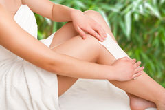 Woman Waxing Her Legs Stock Photography
