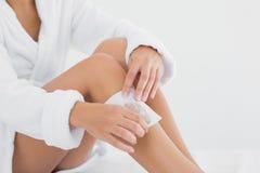 Woman waxing leg at spa center Royalty Free Stock Images