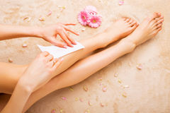 Woman waxing legs. Woman waxing  her beautiful legs Stock Photo