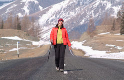 Woman on the way 3. Smiling happy woman walking on the highway Royalty Free Stock Photos