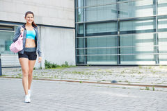 Woman on the way to the fitness center royalty free stock photo