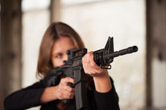 Woman with weapon Stock Photos
