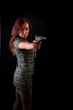 Woman with weapon on a black Stock Photos
