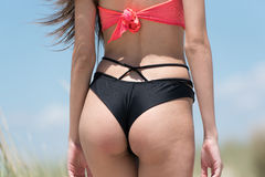 Woman wear bikini, close up on bum Royalty Free Stock Images