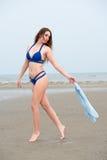 Woman wear bikini holding cloth Royalty Free Stock Image