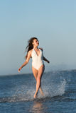 Woman wear bikini run on sea water Royalty Free Stock Photography
