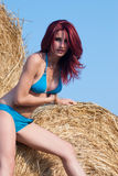 Woman wear bikini standing against haystack Royalty Free Stock Photos