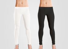 Woman wear blank leggings mockup, black, white,  on grey. Royalty Free Stock Photography