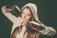 Woman wear boxer gloves with arms in air. Royalty Free Stock Images