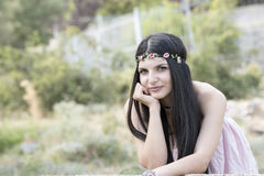 Woman wear flower headpiece and pink dress Stock Images