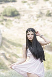 Woman wear flower headpiece and pink dress Royalty Free Stock Images