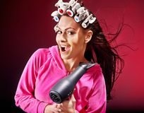 Woman wear hair curlers on head. Stock Image