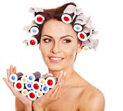 Woman wear hair curlers on head. Stock Photo