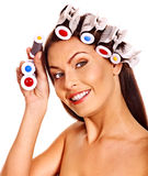 Woman wear hair curlers on head. Stock Photography