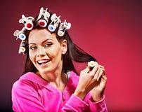 Woman wear hair curlers on head. Stock Photography