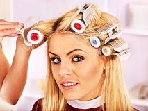 Woman wear hair curlers on head. Royalty Free Stock Photos