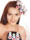 Woman wear hair curlers on head. Royalty Free Stock Photos